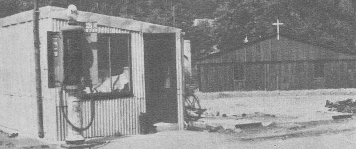 Do you want gas ? See inside this corrugated iron hut. On the right,the new wooden church of La Roche. Le Soir illustré, 1946 service station